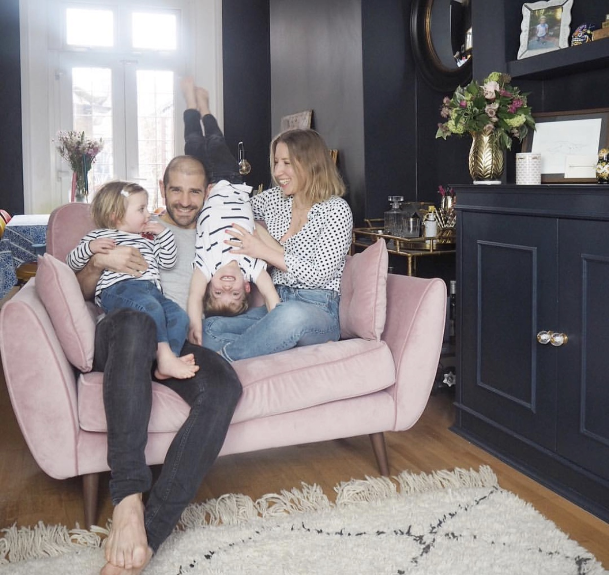 Image of Jess Hurrell with the family on the sofa