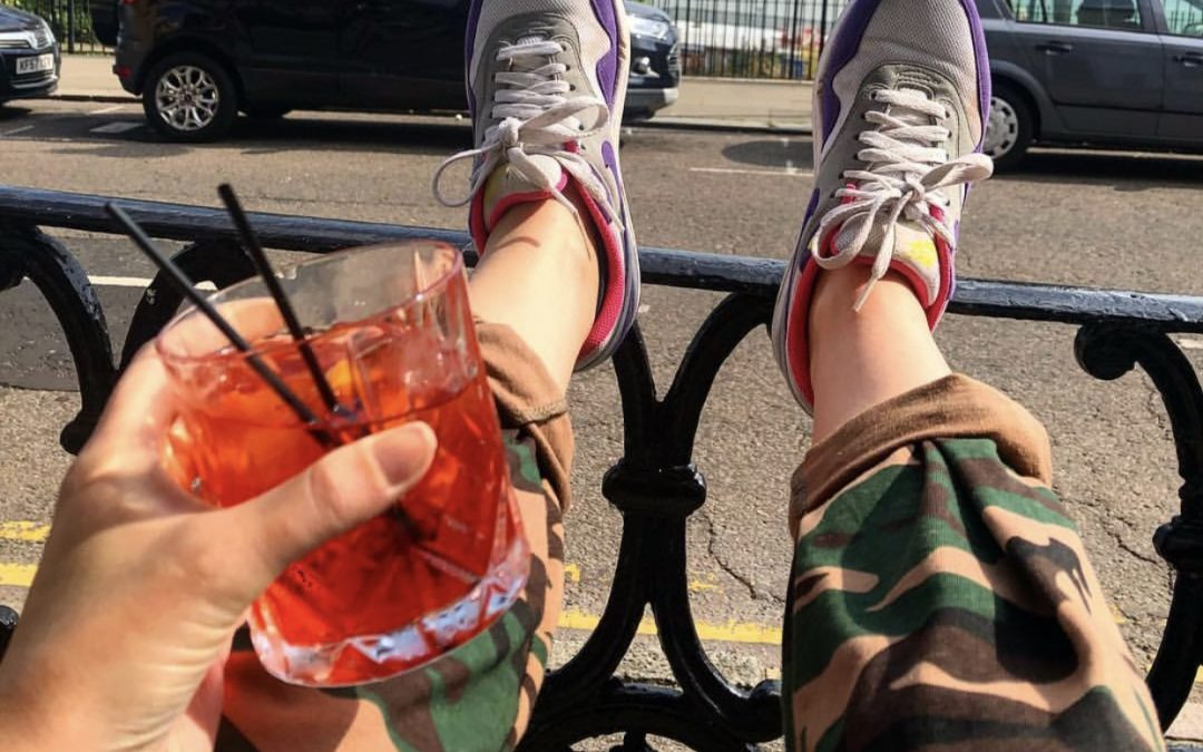 Image of Sarah Akwisombe putting her feet up with a drink